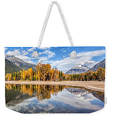 Weekender Tote Bag featuring the photograph Into The Wild by Aaron Aldrich