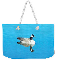 Weekender Tote Bag featuring the photograph Mirror Goose by Kerri Mortenson