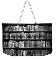 Weekender Tote Bag featuring the photograph Old Books by Chevy Fleet