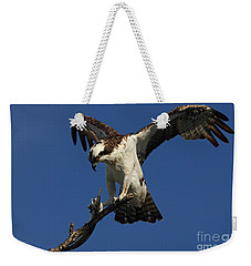 Weekender Tote Bag featuring the photograph Osprey With A Fish Photo by Meg Rousher