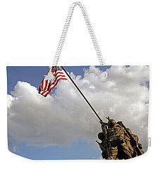 Weekender Tote Bag featuring the photograph Raising The American Flag by Cora Wandel
