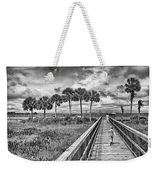 Weekender Tote Bag featuring the photograph Running by Howard Salmon