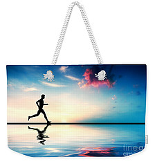 Silhouette Of Man Running At Sunset Weekender Tote Bag