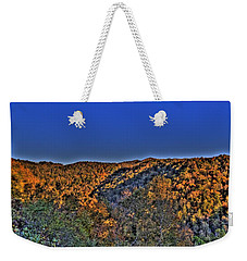 Weekender Tote Bag featuring the photograph Sun On The Hills by Jonny D