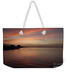 Weekender Tote Bag featuring the photograph Sunrise Over Fort Myers Beach Photo by Meg Rousher