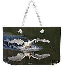 Weekender Tote Bag featuring the photograph Swan Landing by Simona Ghidini