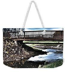 Weekender Tote Bag featuring the photograph Water Under The Bridge by Deborah Klubertanz