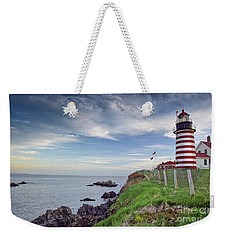 Weekender Tote Bag featuring the photograph West Quoddy Head Lighthouse by Alana Ranney