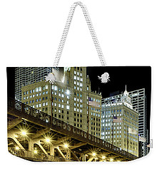 Weekender Tote Bag featuring the photograph Wrigley Building At Night by Sebastian Musial