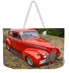 Weekender Tote Bag featuring the photograph 1940 Chevrolet 2 Door Sedan by Peggy Collins