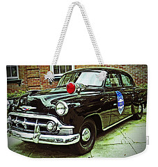 Weekender Tote Bag featuring the photograph 1953 Police Car by Patricia Greer