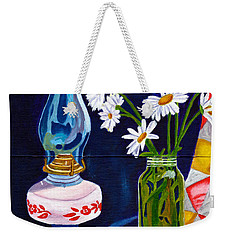 Weekender Tote Bag featuring the painting 2 Books And A Lamp by Laura Forde