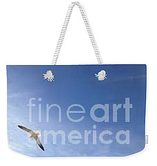 Weekender Tote Bag featuring the photograph Free by Laurie L