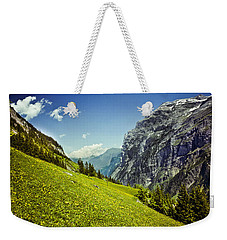 Weekender Tote Bag featuring the photograph Lauterbrunnen Valley In Bloom by Jeff Goulden
