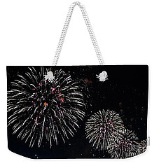 Weekender Tote Bag featuring the photograph Pink Fireworks by Lilliana Mendez