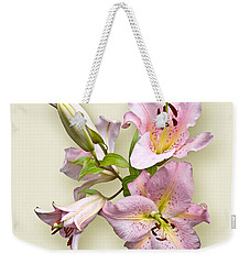 Weekender Tote Bag featuring the photograph Pink Lilies On Cream by Jane McIlroy