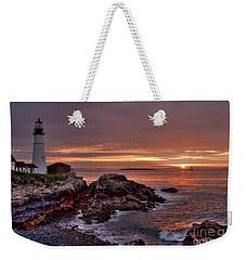 Weekender Tote Bag featuring the photograph Portland Head Lighthouse Sunrise by Alana Ranney