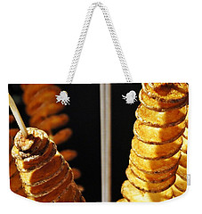 Weekender Tote Bag featuring the photograph Potatoes On A Stick by Lilliana Mendez