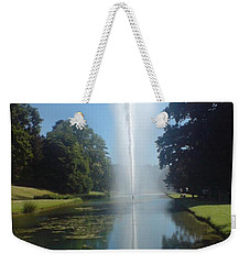 Weekender Tote Bag featuring the photograph Reaching High by Tracey Williams