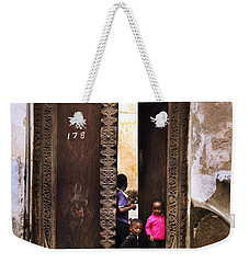 Weekender Tote Bag featuring the photograph Kids Playing Zanzibar Unguja Doorway by Amyn Nasser