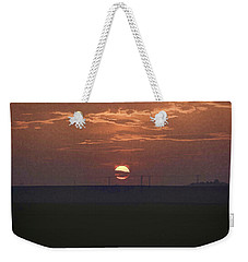 The Setting Sun In The Distance With Clouds Weekender Tote Bag