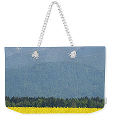 rapeseed field in Brnik with Kamnik Alps in the background Weekender Tote Bag