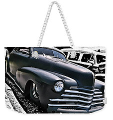 Weekender Tote Bag featuring the photograph '47 Chevy Lowrider by Victor Montgomery