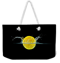 Splashing Lemon Weekender Tote Bag by Peter Lakomy