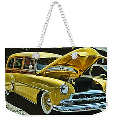Weekender Tote Bag featuring the photograph '52 Chevy Wagon by Victor Montgomery