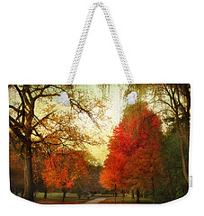 Weekender Tote Bag featuring the photograph Autumn Promenade by Jessica Jenney