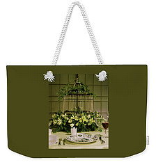 A Birdcage In The Middle Of A Table Weekender Tote Bag