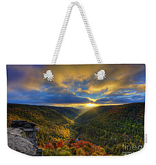 A Blue And Gold Sunset Weekender Tote Bag by Dan Friend