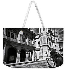 Weekender Tote Bag featuring the photograph A Buck At A Time by Robert McCubbin