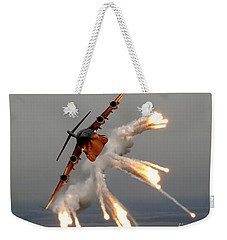 Weekender Tote Bag featuring the photograph A C-17 Globemaster IIi Releases Flares by Stocktrek Images