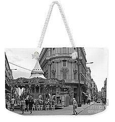 Weekender Tote Bag featuring the photograph A Carousel by Cendrine Marrouat