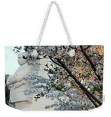 Weekender Tote Bag featuring the photograph A Cherry Blossomed Martin Luther King by Cora Wandel