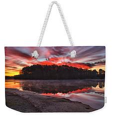 A Christmas Eve Sunrise Weekender Tote Bag by Gordon Elwell