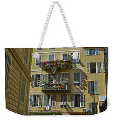 Weekender Tote Bag featuring the photograph A Corner In Nice by Allen Sheffield