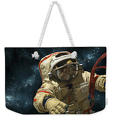 A Cosmonaut Against A Background Weekender Tote Bag