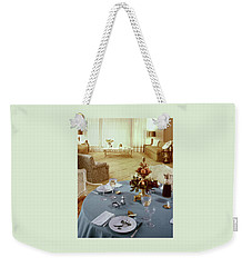 A Dining Room With A Blue Tablecloth And Ornate Weekender Tote Bag