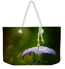 Weekender Tote Bag featuring the photograph A Fairy In The Garden by Rebecca Sherman