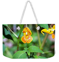 Weekender Tote Bag featuring the photograph A Fragile Flower by Chalet Roome-Rigdon