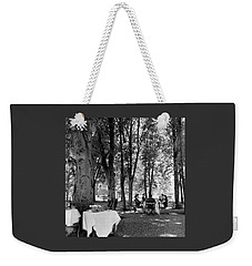 A Group Of People Eating Lunch Under Trees Weekender Tote Bag by Luis Lemus