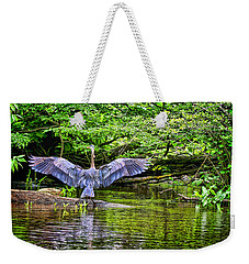 Weekender Tote Bag featuring the photograph A Heron Touches Down by Eleanor Abramson