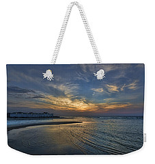 Weekender Tote Bag featuring the photograph a joyful sunset at Tel Aviv port by Ron Shoshani