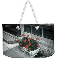 Weekender Tote Bag featuring the photograph A Little Color In A Drab World by Rodney Lee Williams