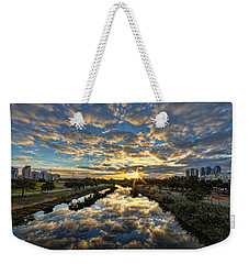 A Magical Marshmallow Sunrise  Weekender Tote Bag by Ron Shoshani