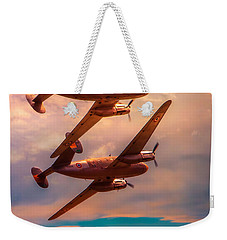 Weekender Tote Bag featuring the photograph A Pair Of Flamingos by Chris Lord