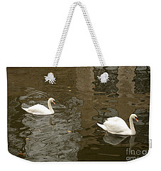 Weekender Tote Bag featuring the photograph A Pair Of Swans Bruges Belgium by Imran Ahmed