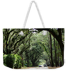 A Pretty Tree Covered Road Somewhere On Hilton Head Island Weekender Tote Bag by Kim Pate